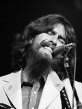 George Harrison Performing at a Rock Concert Benefiting Bangladesh, aka Kampuchea Premium Photographic Print by Bill Ray