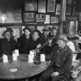 Woody Guthrie Playing and Singing for Patrons of Mcsorley's Bar Premium Photographic Print by Eric Schaal