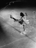 Figure Skater Carol Lynne with Flashlights Embedded in Her Skates Premium-Fotodruck von Gjon Mili