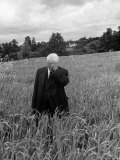 Poet Robert Frost Standing in Oxford Field with His Hand over His Face Premium Photographic Print by Howard Sochurek