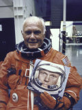 Astronaut John Glenn in Pressure Suit for Flight Into Space Holding Photo of Himself Premium Photographic Print by Ralph Morse
