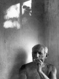 Pablo Picasso, Bare Chested and Smoking Cigarette Premium Photographic Print by Gjon Mili