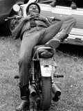 African American Man Relaxing on His Motocycle During Motorcycle Races near Detroit, Michigan Premium Photographic Print by John Shearer