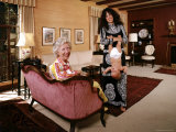 Grace Slick Holding Her Daughter Upside Down by the Ankles Premium Photographic Print by John Olson