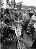 White Rider Preparing to Race at Mostly Black Motorcycle Enthusiasts Premium Photographic Print by John Shearer