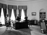 President John F. Kennedy in Oval Office with Brother, Attorney General Robert F. Kennedy Premium Photographic Print by Art Rickerby