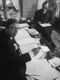 Playwright Jean Paul Sartre at His Desk as Artist Saul Steinberg Sketches at Sartre's Home in Paris Premium-Fotodruck von Gjon Mili