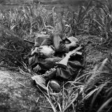 American Infantryman Terry Moore Taking Cover; Japanese Artillery Fire Explodes Nearby During Lámina fotográfica por W. Eugene Smith
