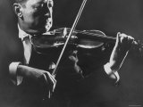 Close Up of Violinist Jascha Heifetz Playing in Mili's Darkened Studio Premium Photographic Print by Gjon Mili