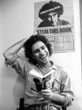 Yippie Leader Abbie Hoffman Holding Copy of His Book Premium Photographic Print by John Shearer