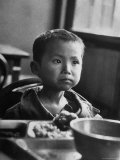 Korean War Orphan Koo Rhode Island Kang, Alone Wearing Ill Fitting Army Fatigue Jacket Premium Photographic Print by Michael Rougier