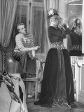 Lady Trying on Gown and Mask with Designer Fath Looking On Premium Photographic Print by David Scherman