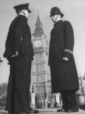 Chief Inspector of Metropolitan Police Stopping for Word with Police Constable in Parliament Square Photographic Print by David Scherman
