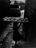Bread Crowded on Large Board Carried on Spanish girl's head in Village of Deleitosa Premium Photographic Print by W. Eugene Smith