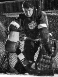 Terry Sawchuck, Star Goalie for the Detroit Red Wings, Warding Off Shot on Goal, at Ice Arena Premium Photographic Print by Joe Scherschel