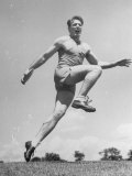 Discus Thrower Fortune Gordian Liftd Both Feet Off Ground When Throwing During US Olympic Tryouts Premium Photographic Print by Joe Scherschel