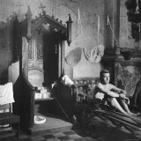 Grave Soldier on Cot Next to Ornate Confessional in Makeshift Hospital in Cens Cathedral Photographic Print by W. Eugene Smith