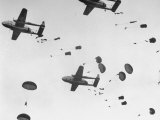"Scores of Paratroopers Dropping from C-82 ""Flying Boxcar"" and Landing on Level Ground Premium Photographic Print by Frank Scherschel"