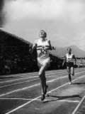 England's Dr. Roger Bannister Beating Australia's Mile Record Holder John Landy Premium Photographic Print by Ralph Morse