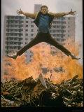 Riff Leaps over Smoldering Rubble of New York Slum Clearance Project in Scene from West Side Story Premium-Fotodruck von Gjon Mili