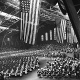 Graduating Cadets Receiving Commissions, US Flags Hanging Above During the Graduation Ceremonies Photographic Print by William C. Shrout