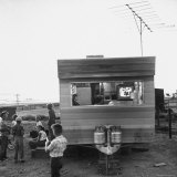 Railroad Construction Worker's Family Watching TV in Trailer at Camp for Southern Pacific Employees Photographic Print by Frank Scherschel