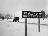 Coca Cola Road Sign on Autobahn Between Munich and Salzburg with Jep Driving Premium Photographic Print by Walter Sanders