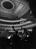 Leopold Stokowski Conducting the New York Philharmonic Orchestra in Performance at Carnegie Hall Premium Photographic Print by Gjon Mili