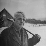 Poet Robert Frost in Affable Portrait, Axe Slung over Shoulder in Wintry Rural Setting Premium Photographic Print by Eric Schaal
