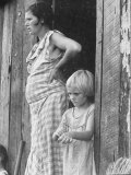 Pregnant Sharecropper&#39;s Wife Standing in Doorway of Wooden Shack with Daughter, the Depression Premium Photographic Print by Arthur Rothstein