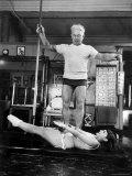 Opera Singer Roberta Peters Balancing Her Trainer, Joseph Pilates, on Her Operatic Breadbasket Metalltrykk av Michael Rougier