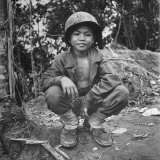 Filipino Boy Travelling with American Soldiers of 33rd Inf. Div. During Fight to Regain Philippines Photographic Print by Carl Mydans