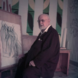 Henri Matisse, Alone, Seated at Easel Displaying One Off His Drawings at His Home in Nice Premium Photographic Print by Gjon Mili