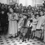 Yugoslavian Children Listening to Girl Sing While Her Partner Plays the Accordion Photographic Print by John Phillips