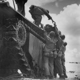 American Soldiers Wounded During Landing on Guam Being Loaded Onto Amphibious Truck for Evacuation Photographic Print by W. Eugene Smith