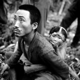 Marianas Island Father with Child After Capture by Americans During Battle Between US and Japanese Photographic Print by W. Eugene Smith
