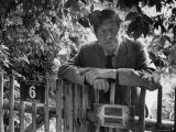 Poet, Wystan H. Auden, Standing Outside Gate of His Home Premium Photographic Print by Harry Redl