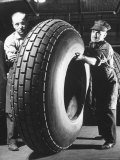 Workers with Truck Tires at Us Rubber Plant Photographie par Andreas Feininger