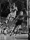Burke Scott of Hoosiers Basketball Team Leaping Through Air Towards Lay Up Shot at Basketball Hoop Premium Photographic Print by Francis Miller