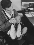Pop Singer Pat Boone Autographing His White Buck Leather Shoes for Charity Reprodukcja zdjęcia premium autor Ralph Morse