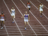US Athlete Michael Larrabee Winning the 400 Meters at the Summer Olympics Premium Photographic Print by George Silk