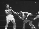 Heavyweight Bout in Which Cassius Clay Narrowly Defeated Doug Jones Premium Photographic Print by George Silk