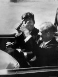 Pres. John F. Kennedy Riding in Limo with Astronaut Col. John Glenn Jr. Giving Thumbs Up Sign Premium Photographic Print by Michael Rougier