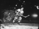 Black Hawks Player Bobby Hull in Game Against Montreal Canadians Premium Photographic Print by Francis Miller