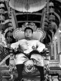 "King Norodom Sihanouk of Cambodia Sitting in His Throne Wearing ""Sampots"", Sarong Style Pants Premium Photographic Print by Howard Sochurek"