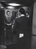 Gregory Peck Trying on Suit for His New Movie Man in the Grey Flannel Suit Reproduction photographique sur papier de qualité par Michael Rougier