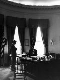 President John F. Kennedy with Brother, Attorney General Robert Kennedy in White House Office Photographic Print by Art Rickerby