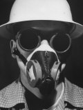 Closeup a A Man Wearing a Safety Helmet, Mask and Goggles Photographic Print by Andreas Feininger