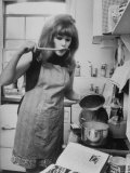 Lynn Redgrave Cooking in Her Apartment Premium Photographic Print by Terence Spencer