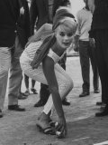 Elke Sommer Playing Petanque at the Cannes Film Festival Premium Photographic Print by Paul Schutzer